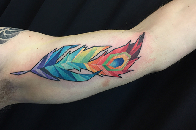 geometric feather tattoo